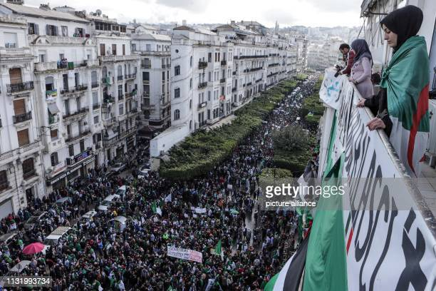 Algerians take part in a mass protest against Algerian President Abdelaziz Bouteflika after his decision to postpone the presidential elections of...