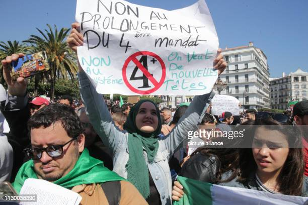 An Algerian student holds a placard during a protest a day after President Abdelaziz Bouteflika announced his withdrawal from the presidential race...