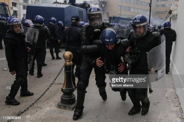 An injured Algerian riot police man during clashes with protestors demonstrating against Algerian President Abdelaziz Bouteflika Bouteflika who has...