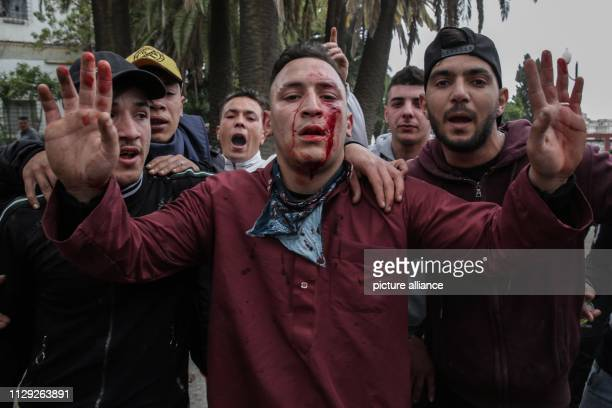 An injured protestor demonstrating against Algerian President Abdelaziz Bouteflika clash with Algerian riot police Bouteflika who has been the...