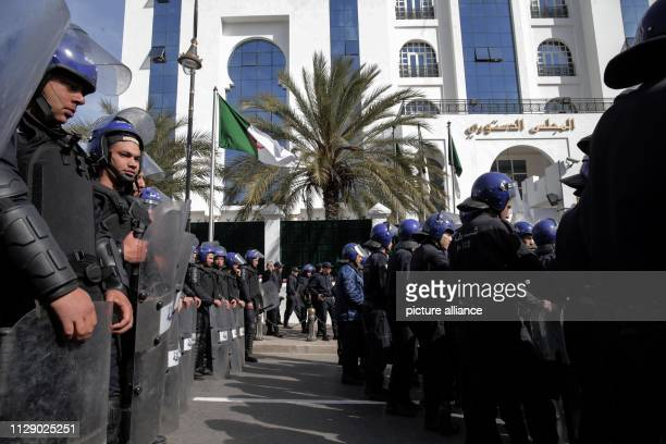 March 2019, Algeria, Algiers: Members of the riot police stand guard outside the Constitutional Council during a demonstration organized by Algerian...