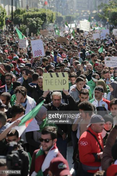 March 2019, Algeria, Algiers: People march with flags and placards during a protest against President Abdelaziz Bouteflika's decision to withdraw...