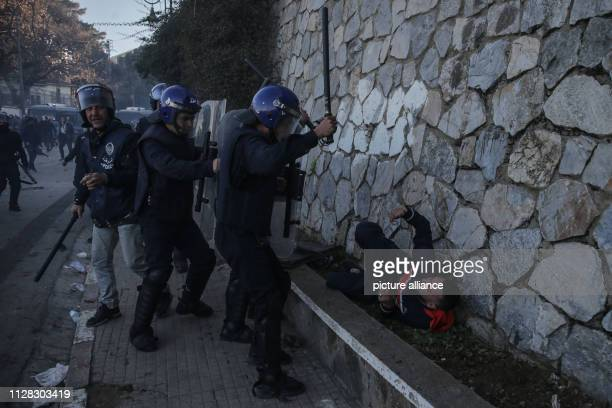March 2019, Algeria, Algiers: Protestors clash with police during a demonstration against the candidacy of Algerian President Abdelaziz Bouteflika...