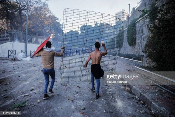 Protestors clash with police during a demonstration against the candidacy of Algerian President Abdelaziz Bouteflika for a fifth term in office...
