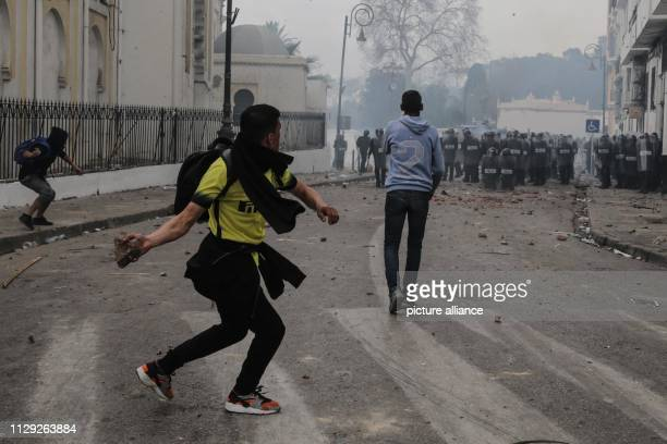 Protestors demonstrating against Algerian President Abdelaziz Bouteflika clash with Algerian riot police Bouteflika who has been the President of...