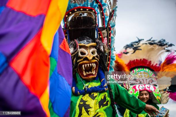 """March 2019, Argentina, Salta: Members of the carnival group """"Los Inca"""" celebrate with masks and colourful robes. For more than 35 years the group has..."""