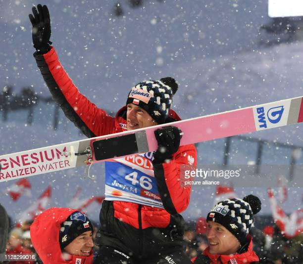 Nordic skiing world championship ski jumping normal hill men 2nd round Winner Dawid Kubacki from Poland cheers with second placed Kamil Stoch and...