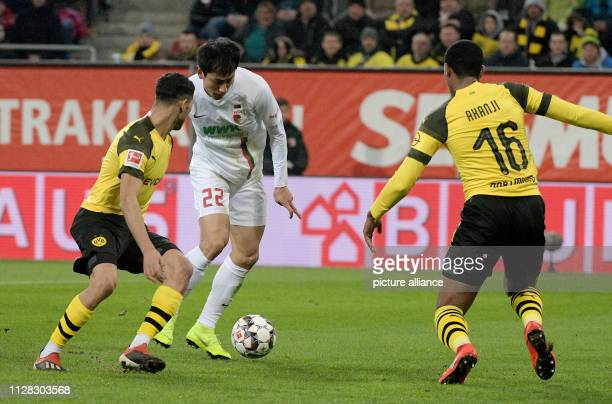 Soccer Bundesliga FC Augsburg Borussia Dortmund 24th matchday in the WWKArena Augsburg's Dong Wong Ji scored the 10 win over Achraf Hakimi and Manuel...