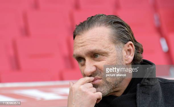 Soccer Bundesliga FC Augsburg Hannover 96 26th matchday in the WWKArena Coach Thomas Doll grabs his lip Photo Stefan Puchner/dpa IMPORTANT NOTE In...