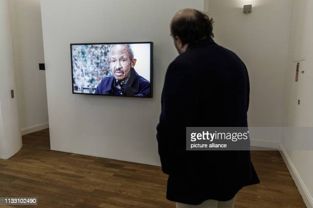 """March 2019, Berlin: A man watches a film contribution on the American painter Jack Whitten in the exhibition """"Jack Whitten. Jack's Jacks"""" at the..."""