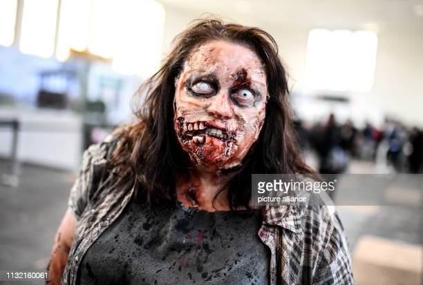 A woman dressed as a zombie walks over the Walker Stalker Con in the Messe Berlin At the meeting for fans of the series Game of Thrones and The...