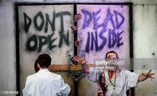 A young man is disguised as a zombie at the Walker Stalker Con in the Messe Berlin At the meeting for fans of the series Game of Thrones and The...