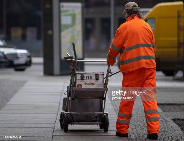 An employee of the city cleaning goes with his car over a sidewalk Photo Monika Skolimowska/dpaZentralbild/dpa