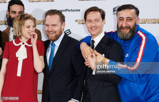 Film producer Alireza Golafshan is half covered by the actors of his film Jella Haase Axel Stein Tom Schilling and Kida Khodr Ramadan The main actors...