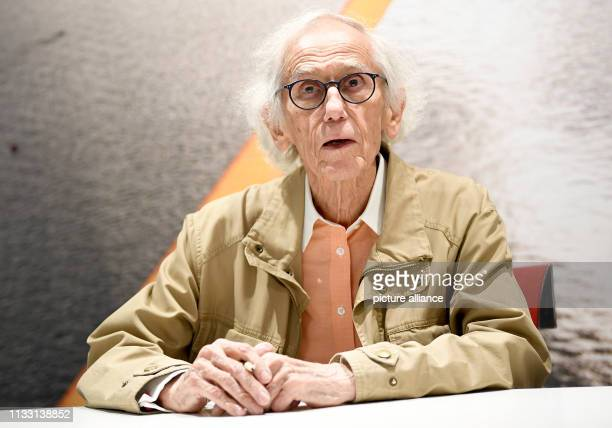 Hiding artist Christo signs his books Hidden Reichstag The Floating Piers and Barrels and The Mastaba in the flagship store of a publishing house The...