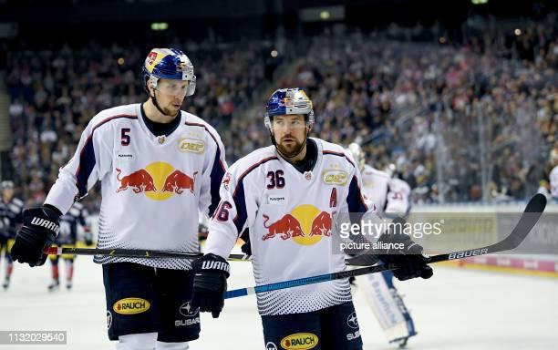 Ice hockey DEL Eisbären Berlin EHC Red Bull Munich championship round quarter finals 4th matchday Munich's Keith Aulie and Munich's Yannic Seidenberg...