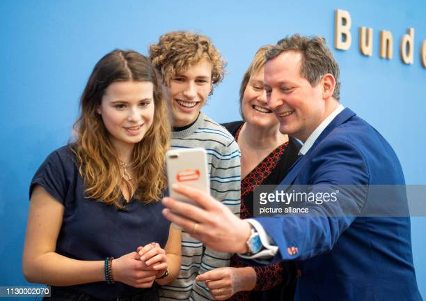 Luisa Neubauer and Jakob Blasel representatives of the Fridays for Future student initiative will hold a selfie with Karen Helen Wiltshire Deputy...