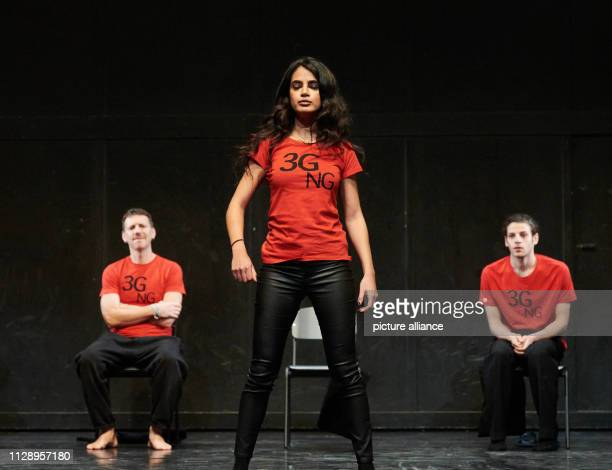The actress Lamis Ammar performs on stage while in the background Knut Berger and Karim Daoud are sitting on chairs watching The photo rehearsal...
