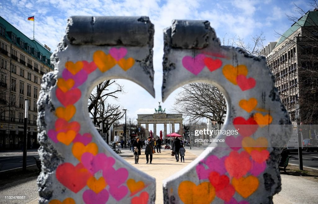 DEU: Wall Heart In Front Of Brandenburg Gate