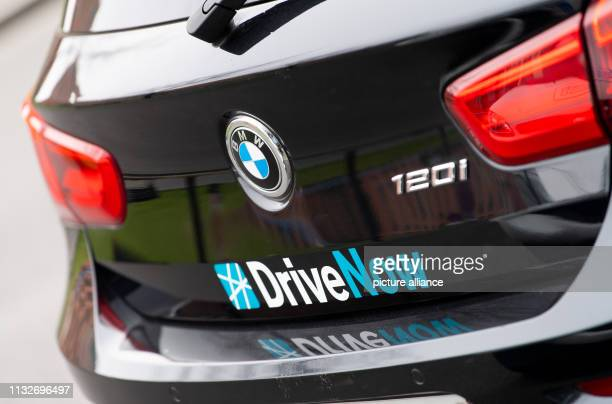 The logo of the car sharing provider DriveNow is attached to the tailgate of a car Photo Monika Skolimowska/dpaZentralbild/dpa