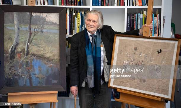 Klaus Runze grandnephew of the painter Hannah Schreiber de Grahl stands between two of the artist's works in the Potsdam Museum during a press...