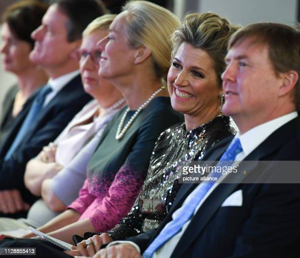Maxima Queen of the Netherlands smiles next to her husband WillemAlexander King of the Netherlands in a speech at the Alfred Wegener Institute Every...