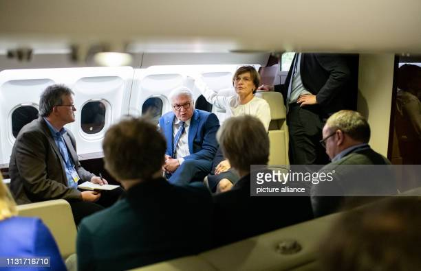 Federal President FrankWalter Steinmeier and his wife Elke Büdenbender talk to accompanying journalists on the flight from Berlin to Zagreb President...