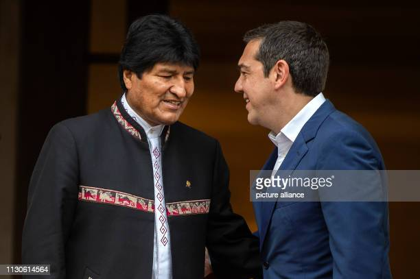 Alexis Tsipras Prime Minister of Greece welcomes Evo Morales President of Bolivia before a meeting at Maximos Mansion as part of Morales' twoday...