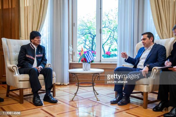Alexis Tsipras Prime Minister of Greece talks to Evo Morales President of Bolivia at a meeting at Maximos Mansion as part of Morales' twoday visit to...