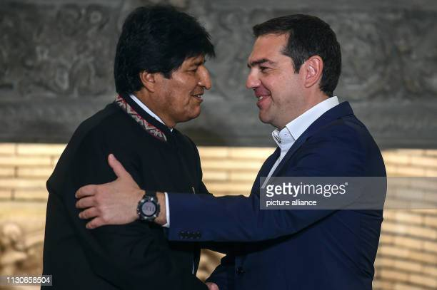 Alexis Tsipras Prime Minister of Greece speaks to Evo Morales President of Bolivia during a press conference at a meeting at Maximos Mansion as part...