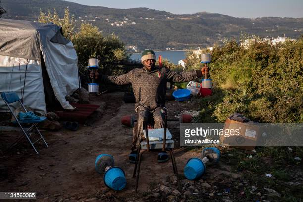 In the early morning a refugee keeps fit with exercises in front of his tent in the refugee camp on the Greek island of Samos Around 4500 refugees...