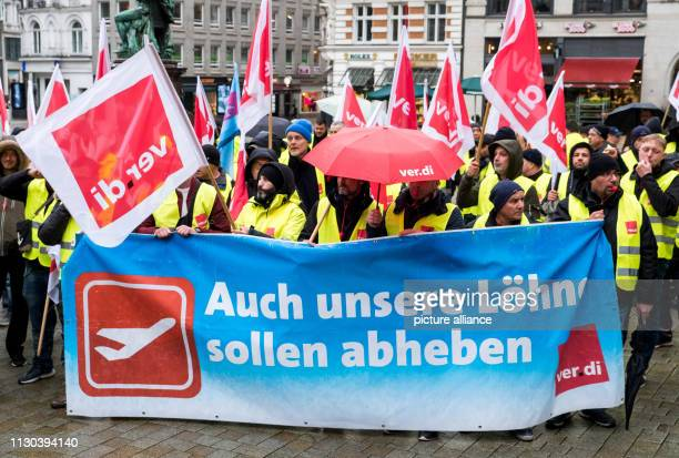 During a warning strike employees of the baggage and aircraft handling department at Hamburg Airport take part in a rally of the Verdi trade union in...