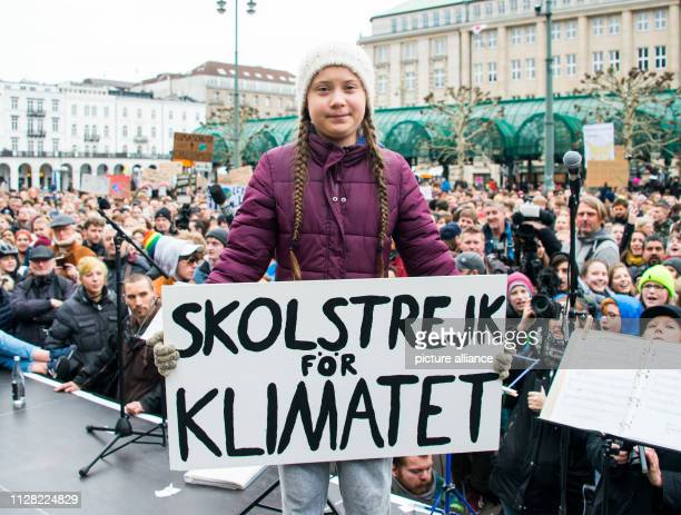 Greta Thunberg climate activist stands on a stage during a rally at the town hall market The young Swedish woman has come to Germany for the first...