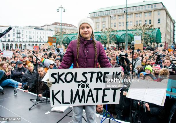 Greta Thunberg climate activist stands with a banner on a stage during a rally on the town hall market The young Swedish woman has come to Germany...