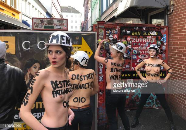 With a bare upper body and a flex activists in the red light district of St Pauli dismantle a privacy screen on Herbertstrasse With this action the...