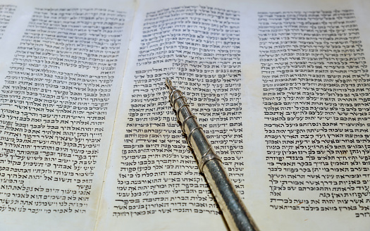 NEW YORK NY March 2019. Hebrew religious Torah old scroll book parchment 1160880630
