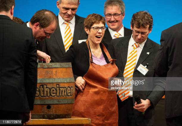 Annegret KrampKarrenbauer CDU federal chairman puts on an apron for the beer tapping on stage at the late Political Ash Wednesday of the CDU Hessen...