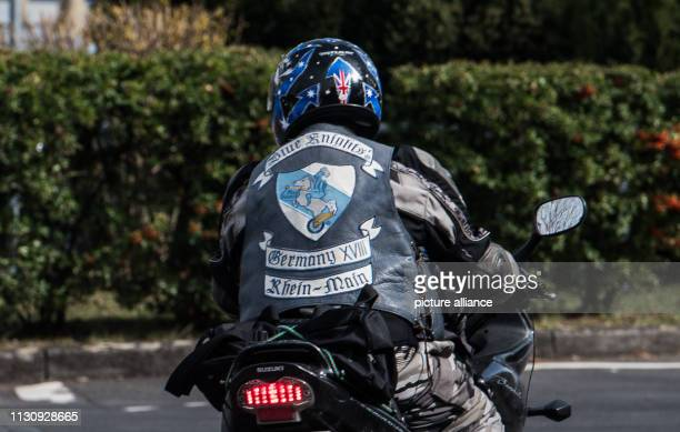 A man in the Blue Knights' frock rides his motorcycle Membership in a chapter is open to anyone who is a police officer customs investigator or law...
