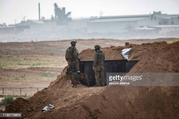 A picture taken from the Israeli side of the IsraelGaza border shows an soldiers of the Israeli forces taking positions during clashes with...