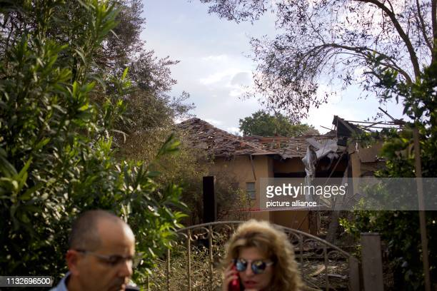 A general view shows a damaged house after it was hit by a rocket in the community of Mishmeret Seven people were injured by a rocket fired from the...