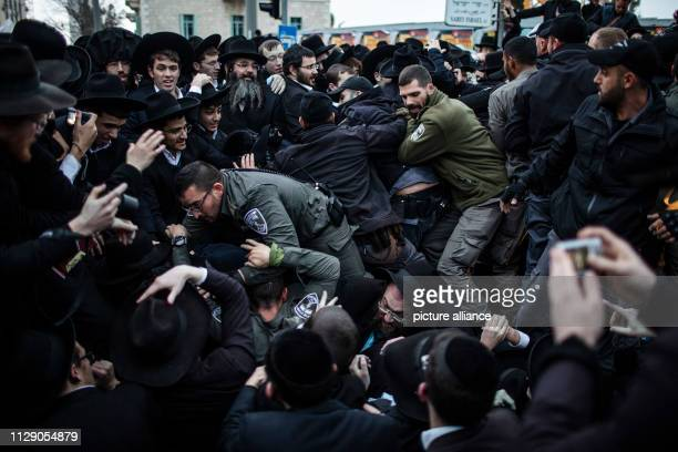 Israeli policemen attempt to disperse UltraOrthodox Jewish protesters during a demonstration against Israeli army conscription Photo Ilia...