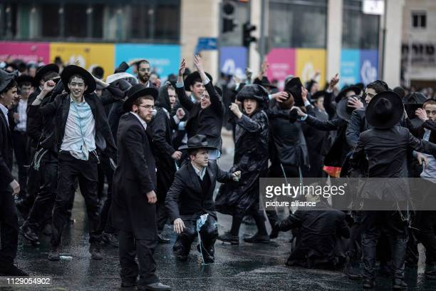 UltraOrthodox Jewish protesters soaked with water from police water cannons shout slogans during a demonstration against Israeli army conscription...