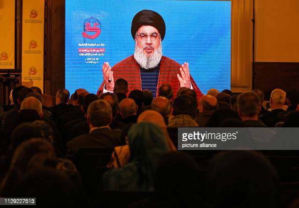 March 2019, Lebanon, Beirut: Pro-Iranian Hezbollah supporters listen to the speech of Hassan Nassrallah, Secertary General of Hezbollah via video...