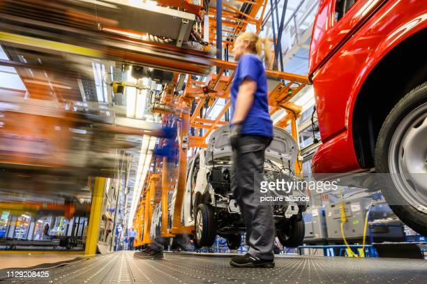 Employees assemble the front end of a Volkswagen T6 on the assembly line at the VW plant in Hanover Photo Christophe Gateau/dpa