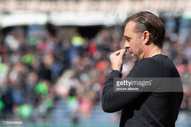 Soccer Bundesliga Hannover 96 FC Schalke 04 27th matchday in the HDIArena Hanover coach Thomas Doll gestures before the match in the stadium Photo...