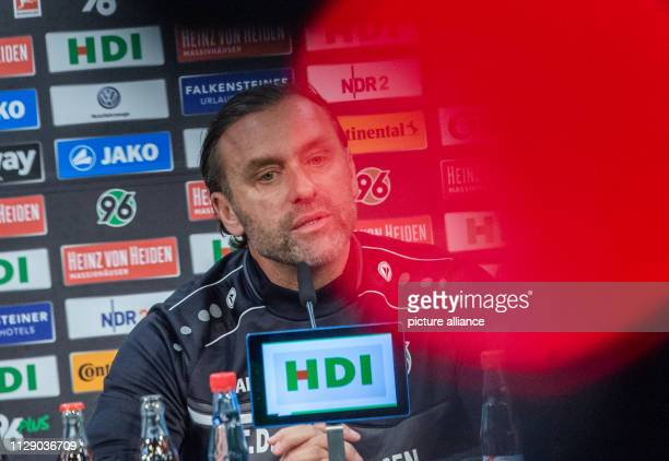 Thomas Doll coach of Hannover 96 sits in a press conference of the soccer club Hannover 96 before the match against Leverkusen Coach Doll and manager...