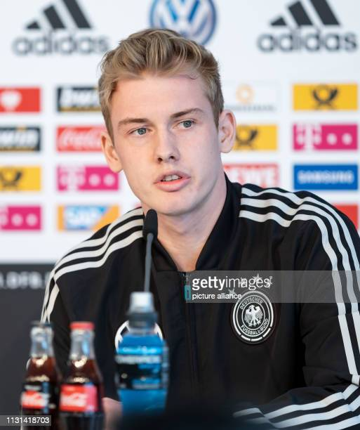 March 2019, Lower Saxony, Wolfsburg: Football national team press conference: the German national player Julian Brandt speaks during the media talk....