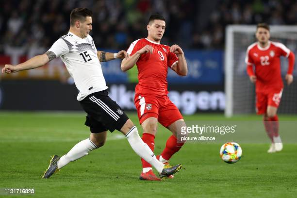 Soccer International match Germany Serbia in the Volkswagen Arena Niklas Süle from Germany and Luka Jovic from Serbia fight for the ball IMPORTANT...
