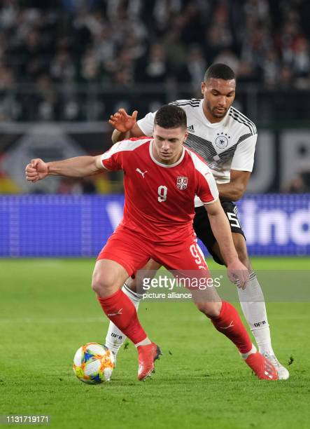 Soccer International match Germany Serbia in the Volkswagen Arena Germany's Jonathan Tah and Luka Jovic from Serbia fight for the ball IMPORTANT NOTE...