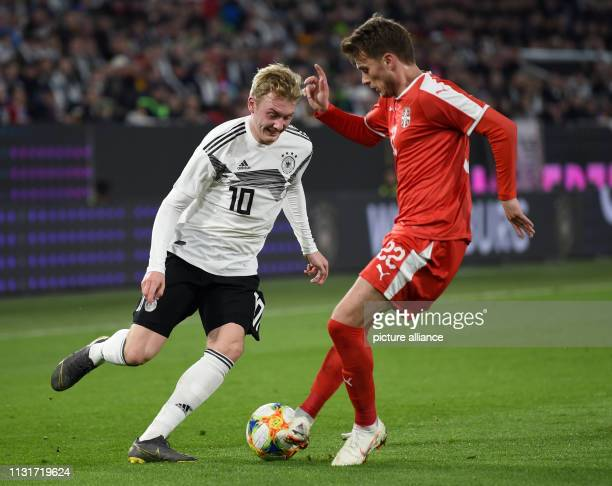 Soccer International match Germany Serbia in the Volkswagen Arena Germany's Julian Brandt and Adem Ljajic from Serbia fight for the ball IMPORTANT...
